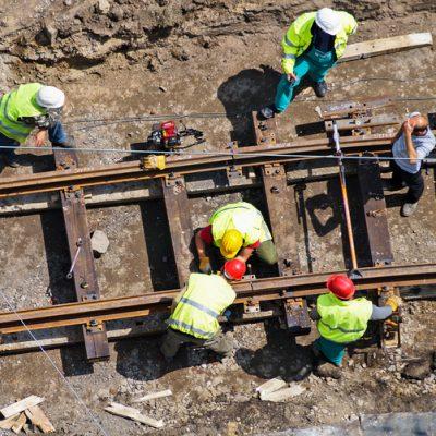 A group of men constructing a railway